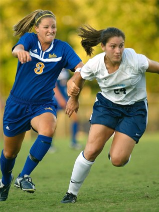 "Photo ""North Carolina's Jessica Maxwell v. UCLA's Kim Devine"" in 2003 by Shane Lardinoi @ nc-soccer.com"