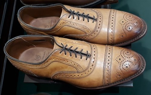 In leather of the walnut hue, here's a pair of Allen Edmonds Strands Wingtip Oxford men's shoes.