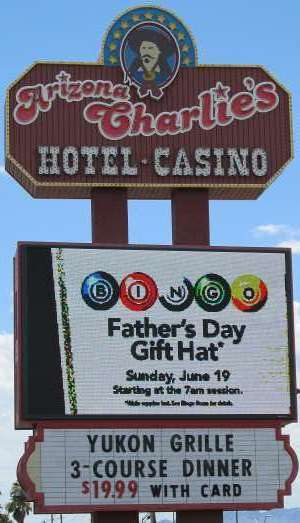 Pic of the sign along Boulder Highway for Arizona Charlie's Hotel Casino in Las Vegas, NV, home of the Palace Grand Lounge, the Market Buffet, and the Yukon Grille.
