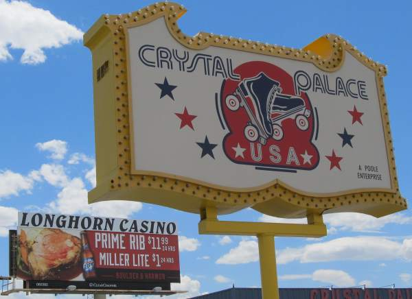 Pic of the Crystal Palace USA Roller Skating Rink sign in from of a billboard for the specials at the Longhorn Casino on Boulder Hwy in Las Vegas, NV.