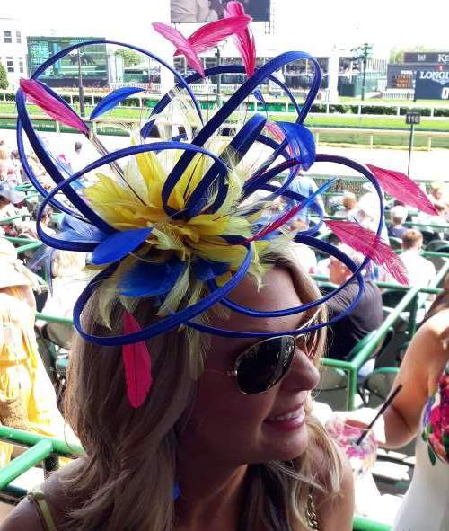 The fascinator on a beautiful blonde at Churchill Downs in Louisville, Kentucky on Thurby 2019.