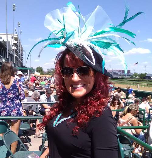 Here's a pic of lovely redhead with a fascinator in the stands at Chruchill Downs in Louisville, but NOT at either the Kentucky Derby or the Kentucky Oaks horse races.