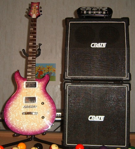 Photo of my Daisy Rock Starburst Elite with the Crate Powerblock amp head and Crate Mini-Full-Stack