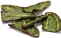 Pic of a plate of grilled jalapeno slices.