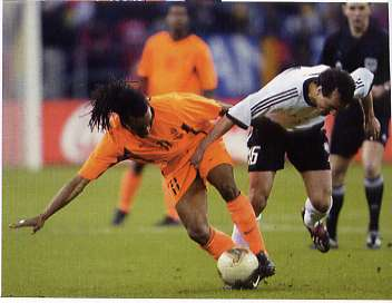 "Phtoto Credit: FourFourTwo Magazine July 2004 edition, page 120 from the article ""Good vs. Evil"" by Simon Kuper featuring Germany's Jens Jeremies grabbing the shorts of Holland's Edgar Davids."