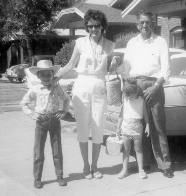 If memory serves, this is myself on the left with my family including Warner Marshall Kimbro and Edna Mae Kimbro and my sister Sharon Jane Kimbro, in front of our home at 2223 North 9th Street in Phoenix, Arizona.