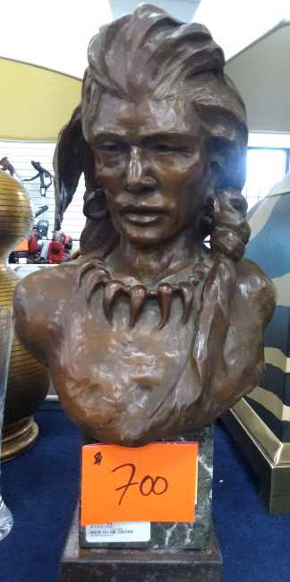 Face of a Native American Indian brave as depicted in bronze sculpture by artist Ron Gurule of Sante Fe, New Mexico and Scottsdale, Arizona.