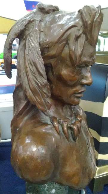 Left side view of the bronze bust of a Native Indian Brave found by the author at a Cash America Pawn shop in Dallas, Texas, the work of artist Ron Gurule of New Mexico and Arizona.