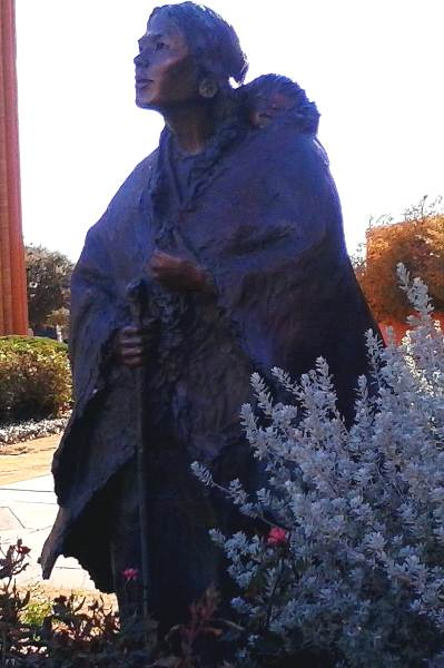 Photo of a statue of Lewis and Clark expedition member Sacagawea carrying her son Jean Baptiste Charbonneau on display at the National Cowgirl Museum in Fort Worth, TX.