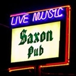 Neon sign of The Saxon Pub on Lamar Street in Austin, TX.  Live music is the main course of the fine club, as I've seen both Carolyn Wonderland and The Paula Nelson Band play there.