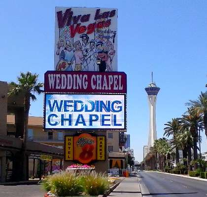 Pic of the world famous Viva Las Vegas Wedding Chapel at the Super 8 Hotel North Strip on Las Vegas Blvd, with The Stratosphere Las Vegas in the background.