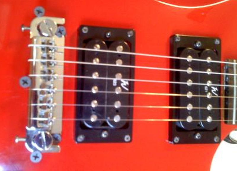 Repairing the wraparound bridge on a BC Rich Warlock model electric guitar, specifially the Bronze series Warlock.  Not the pickup upgrade to the Washburn 620 series (621 and 623) pickups.