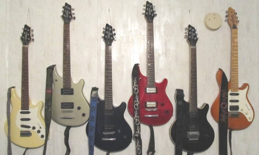 My Washburn BT-Series guitar collection, including a Washburn Bantum BT-3, a Washburn Maverick BT-2 with an HB-102 Duncan Designed pickup set, a Washburn Maverick Series BT-2 with P90's, a Washburn Maverick Series BT-8 with DeArmand USA pickups, Washburn Maverick Series BT-10, and Washburn BillyT with 600 Series PUPs.