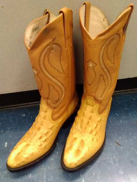 Photo of a pair of cowboy boots in British Tan, taken at the Cash America Pawn Shop on Harry Hines Blvd in Dallas, Texas.