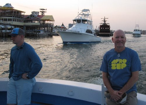 Rocking an awesome t-shirt celebrating the AfroZep band, that's poet Chrome Dome Mike with Thomas Maxwell of the US Army onboard the mighty charter fishing boat Big John which docks near the Emerald Bay at Harborwalk Village in Destin, Florida.