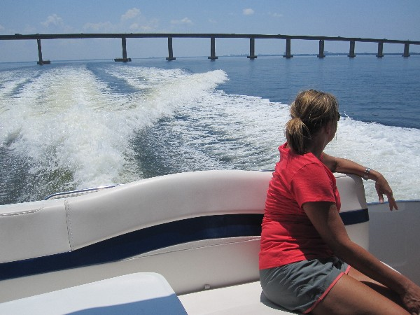 Mrs. Barbara Maxwell looking out over Choctawhatchee Bay to Destin's Mid-Bay Bridge.