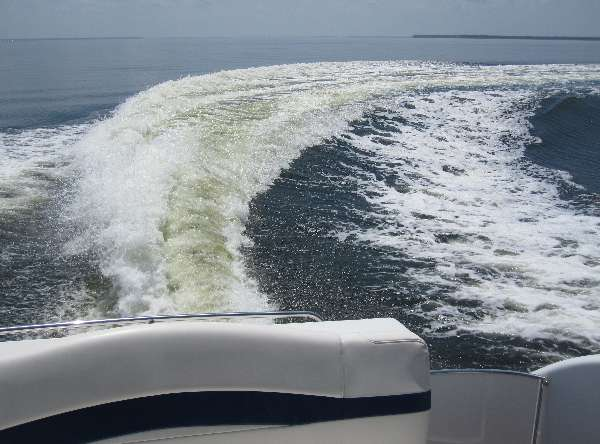View of the wake while carving a turn on the intracoastal waterway North of Destin, Florida.