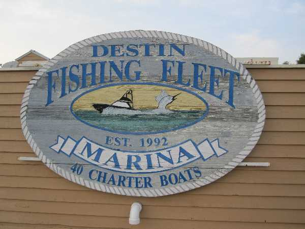Photograph of the Destin Fishing Fleet sign at the marina by the Emerald Grande at Harborwalk Village.