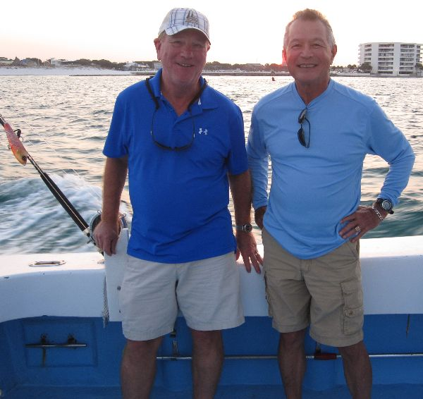 Gary Maxwell and Gene Ursten of Destin Florida on board a charter fishing boat which docks near the Emerald Grand at Harborwalk Village.