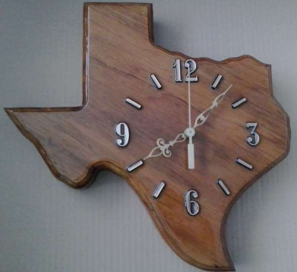 Pic of handmade wall clock in the shape of Texas #1396 by Bob Harbison of Kraf Naf of Hurst, made of pecan from the clear fork of the Brazos River in Stephans County Texas.