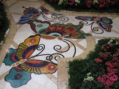 At the Encore and The Wynn Las Vegas Resorts you'll find a butterfly on the floor every 10 feet.  They are beautiful.