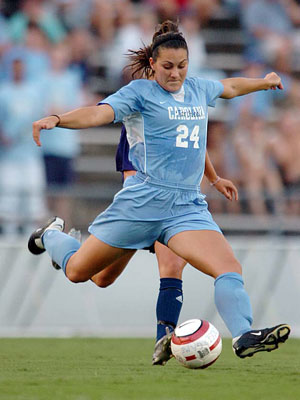 Photo Credit:  UNC Sports Site, http://tarheelblue.cstv.com/, photo of tarheel central defender and four time All-American (twice while in high school & twice in college) Jessica Maxwell, graduate of Colleyville (TX) Heritage High School