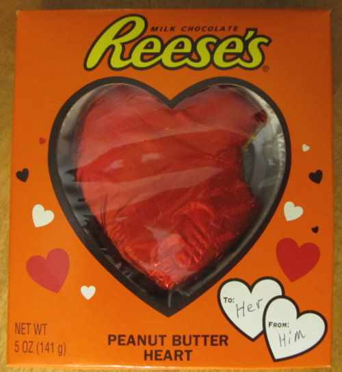 A heart with a bite missing made of Reese's peanut butter with milk chocolate.