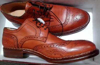In orange, men's shoes by Bergdorf Goodman found at Neiman Marcus Last Call in Grapevine.