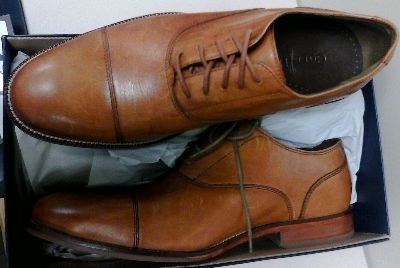 In a British Tan finish, here's a pair of Cole Haan Williams Cap Toe shoes for men.
