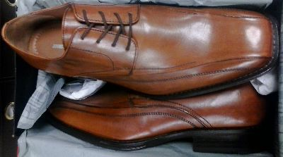 In tan, a pair of Johnson and Murphy Harding Panel men's shoes.
