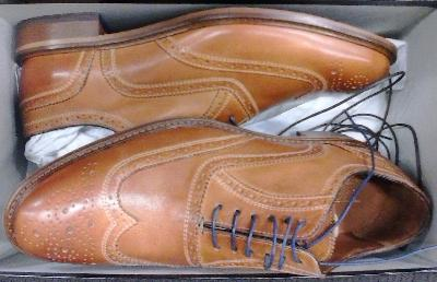 Here's Mercanti Fiorentini brogue men's shoes in golf tan, which appear to be an exclusive offering of DSW Designer Shoe Warehouse.