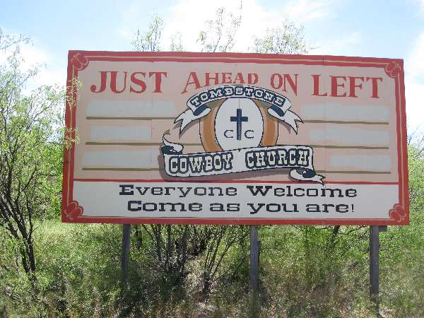 Photo of the sign promoting the Tombstone Cowboy Church on Fremont Street in Tombstone, AZ