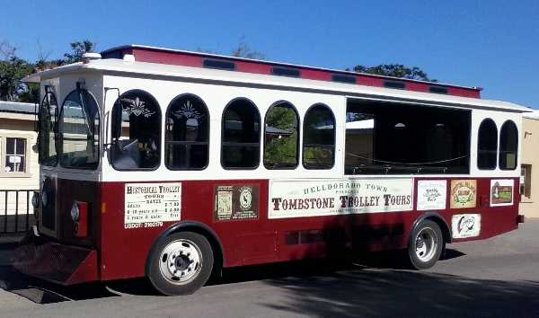 Photo of the Tombstone Trolley Tours bus-like vehicle employed by  the Helldorado Town Wild West theme park which features panning for gold.