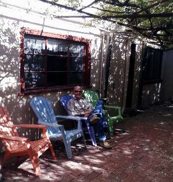 Photo taken of Chrome Dome Mike relaxing at The Rose Tree Exhibit and 1880 Museum on 4th Street in Tombstone, AZ, taken in April 2015.