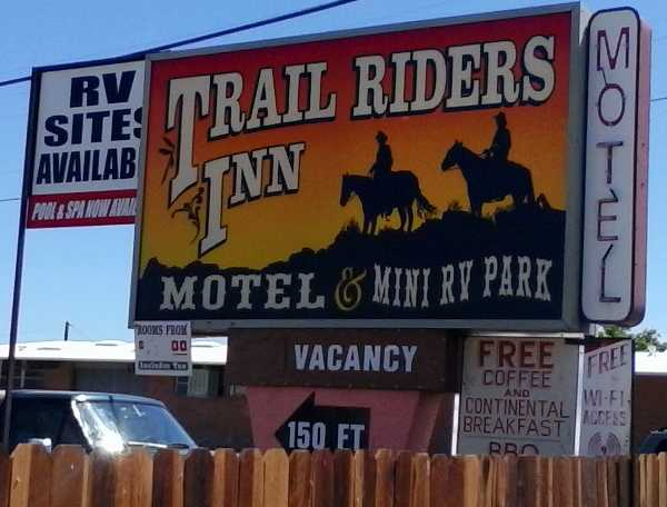 Photo of the signage for The Trail Riders Inn Motel and Mini RV Park in Tombstone, AZ.