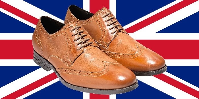 A true icon of Men's fashion, the British Union Jack flag with a pair of men's Cole Haan Copley wingtip derby oxford shoe in genuine British tan leather, image created by the author of this poem about men's fashion.